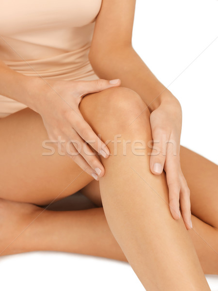 hands touching knee Stock photo © dolgachov