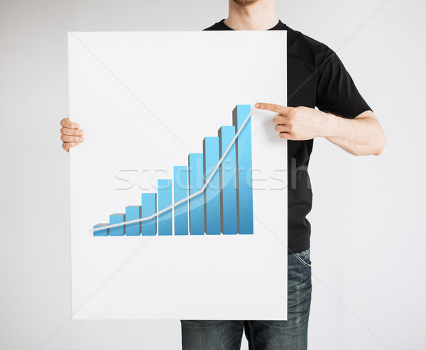 man holding board with 3d graph Stock photo © dolgachov