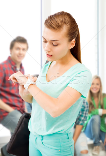student girl looking at wristwatch Stock photo © dolgachov