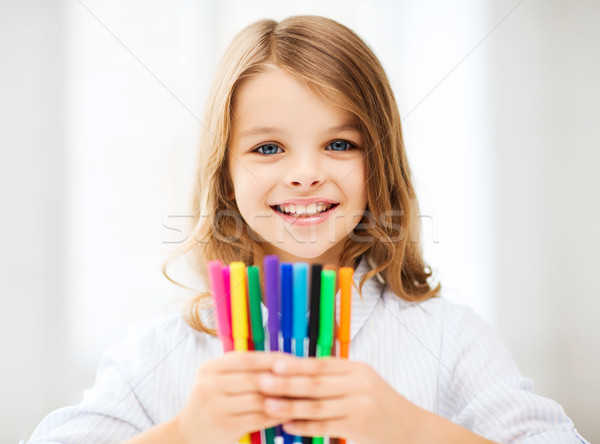 girl showing colorful felt-tip pens Stock photo © dolgachov