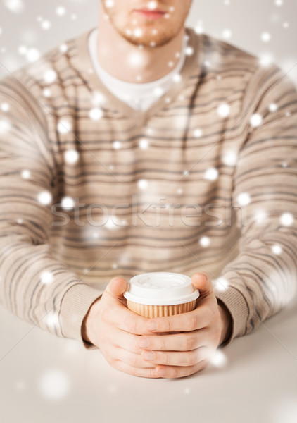 man hand holding take away coffee cup Stock photo © dolgachov