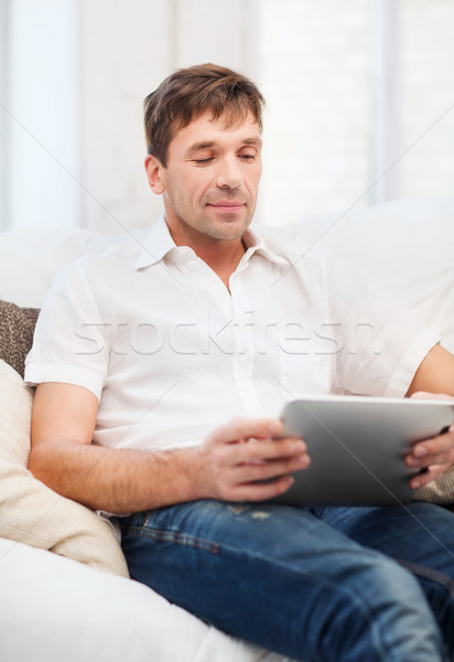 man working with tablet pc at home Stock photo © dolgachov