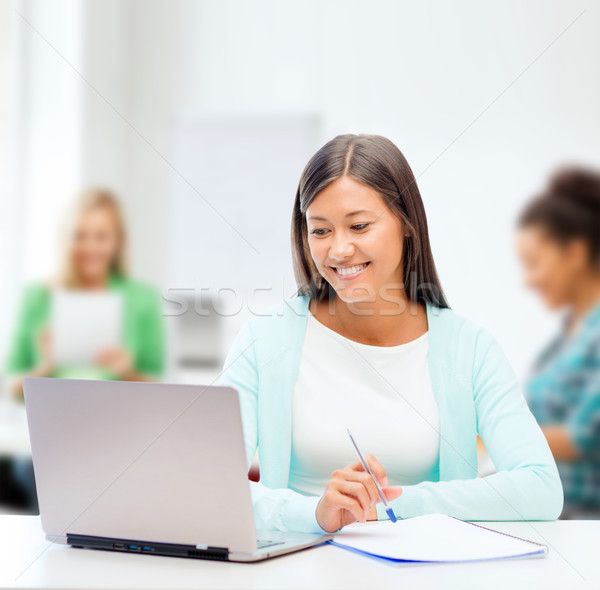Stock photo: asian businesswoman with laptop and documents