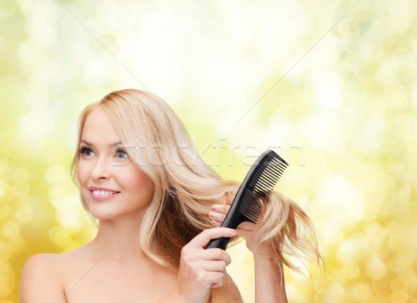 smiling woman with hair brush Stock photo © dolgachov