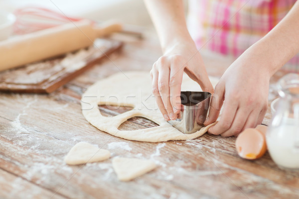 close up of hands making cookies from fresh dough Stock photo © dolgachov