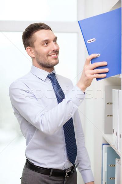 Bonito empresário dobrador escritório negócio Foto stock © dolgachov