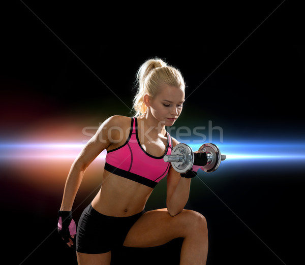 young sporty woman with heavy steel dumbbell Stock photo © dolgachov