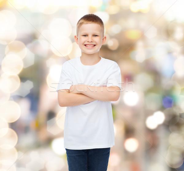 Sonriendo pequeño nino blanco camiseta publicidad Foto stock © dolgachov