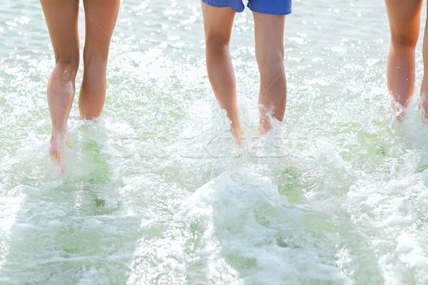 Stock photo: close up of human legs on summer beach