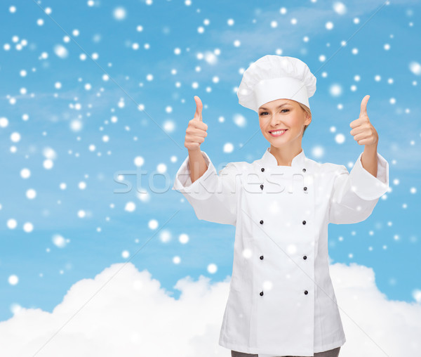 Mosolyog női szakács mutat felfelé karácsony Stock fotó © dolgachov
