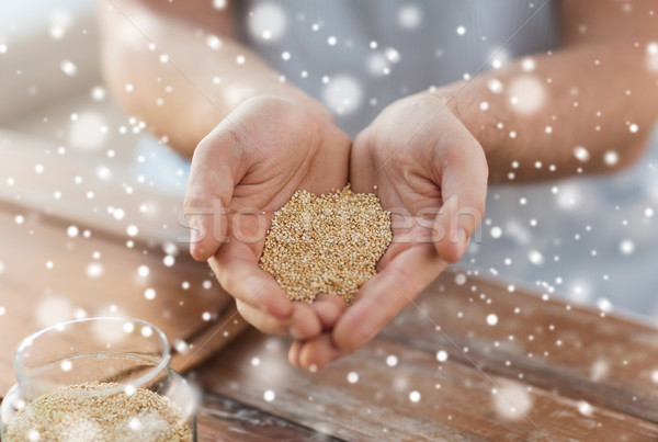close up of male cupped hands with quinoa Stock photo © dolgachov