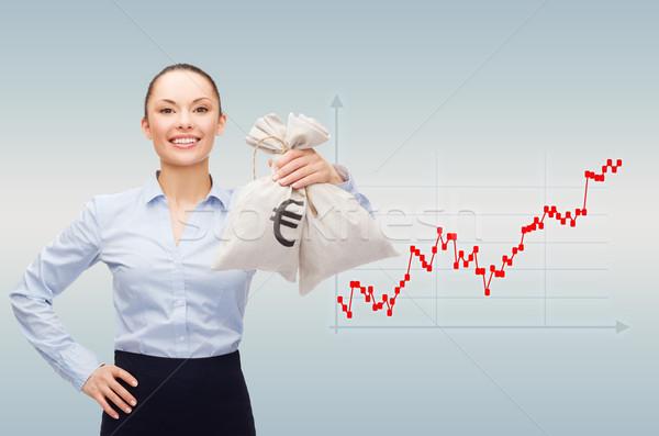 Mutlu işkadını para çanta dolar Stok fotoğraf © dolgachov