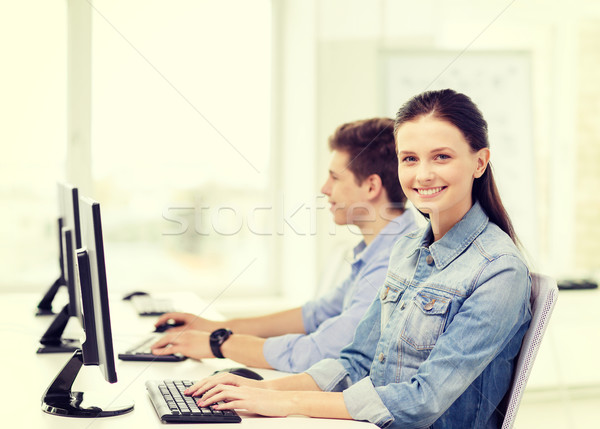 two smiling students in computer class Stock photo © dolgachov
