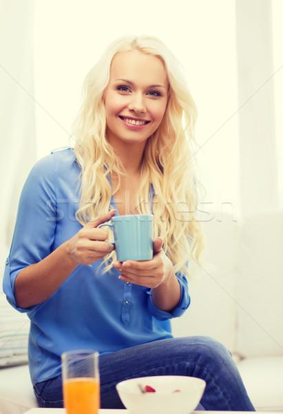 Gülümseyen kadın fincan çay kahvaltı sağlık gıda Stok fotoğraf © dolgachov