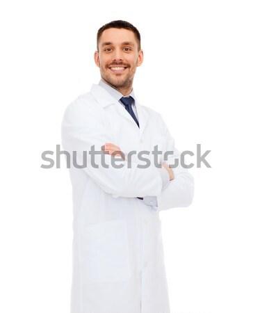 smiling male doctor in white coat Stock photo © dolgachov