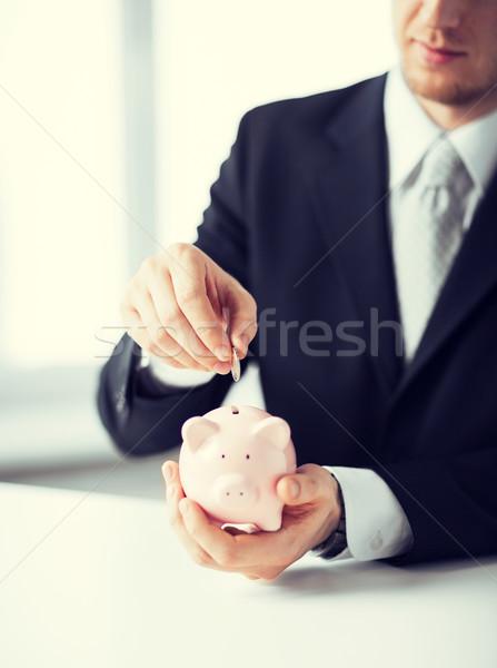 Férfi érme kicsi persely kép üzlet Stock fotó © dolgachov