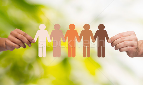 Stock photo: hands holding paper chain multiracial people