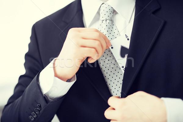 mans hand hiding ace in the jacket pocket Stock photo © dolgachov