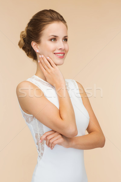 Stock photo: smiling woman in white dress with diamond ring