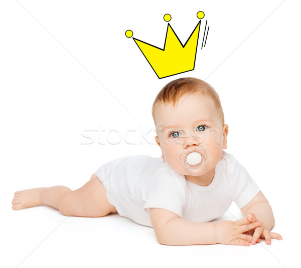 smiling baby lying on floor with dummy in mouth Stock photo © dolgachov