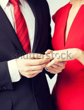 close up of male gay couple with wedding rings on Stock photo © dolgachov