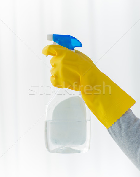 close up of hand with cleanser spraying Stock photo © dolgachov