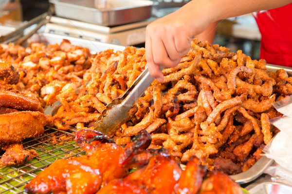 close up of cook hands and snacks at street market Stock photo © dolgachov