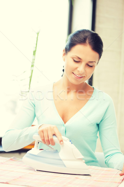 lovely housewife with iron Stock photo © dolgachov