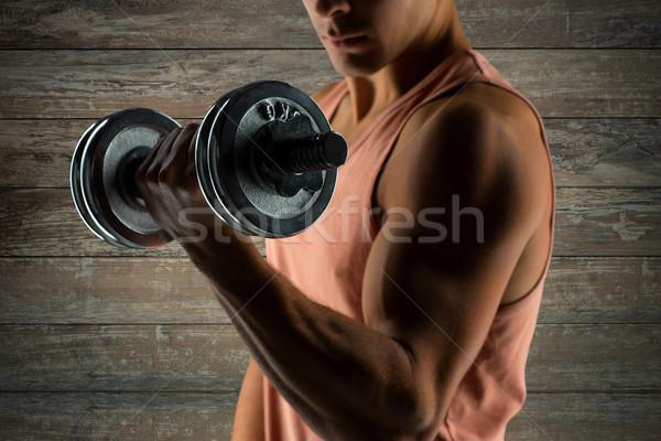 Jeune homme biceps sport fitness Photo stock © dolgachov