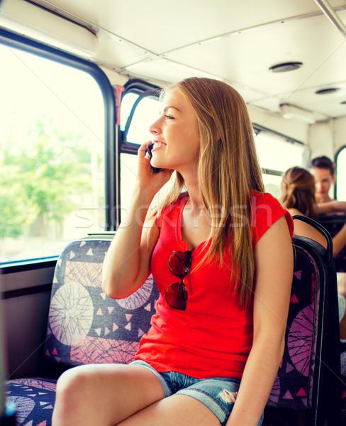 улыбаясь смартфон автобус путешествия отпуск Сток-фото © dolgachov