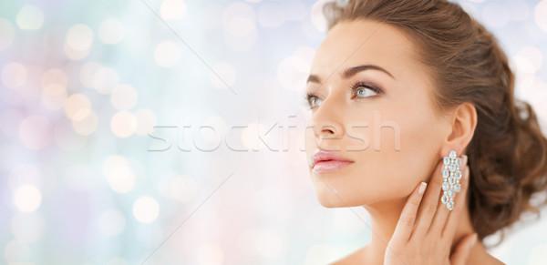 Vrouw diamant oorbellen mensen schoonheid sieraden Stockfoto © dolgachov