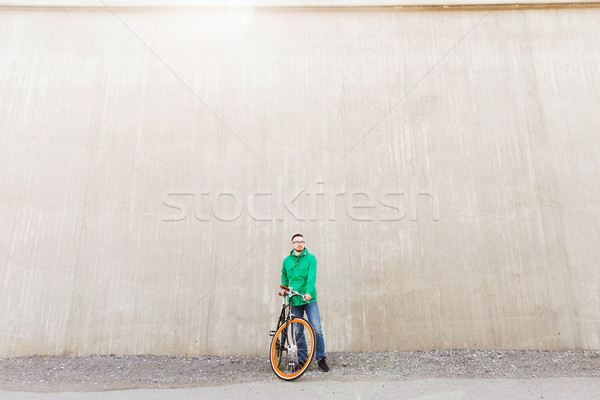 Stock photo: happy young hipster man with fixed gear bike