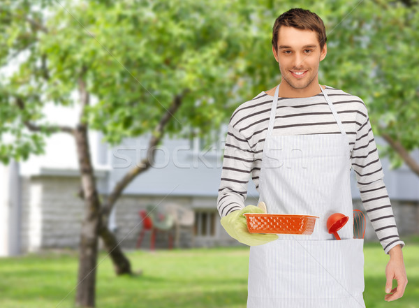 Mutlu adam pişirmek mutfak gereçleri insanlar Stok fotoğraf © dolgachov