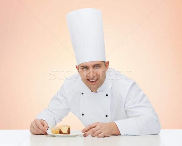Boldog férfi szakács szakács desszert főzés Stock fotó © dolgachov