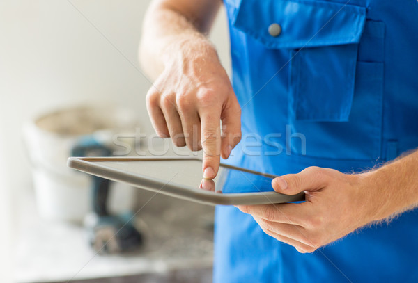 close up of builder or workman with tablet pc Stock photo © dolgachov