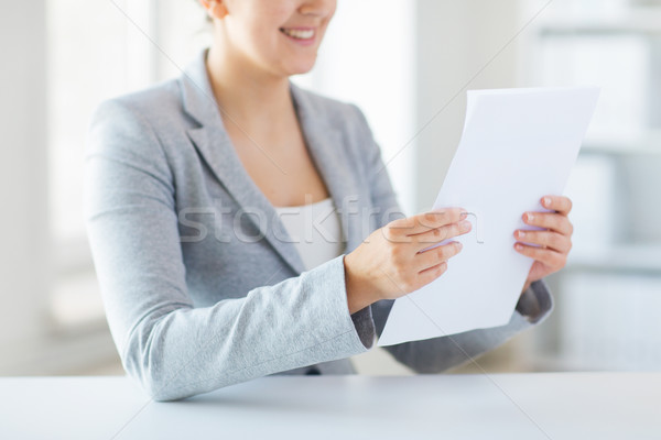 close up of woman reading papers or tax report Stock photo © dolgachov