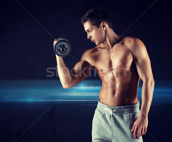 若い男 ダンベル 上腕二頭筋 スポーツ ボディービル 訓練 ストックフォト © dolgachov