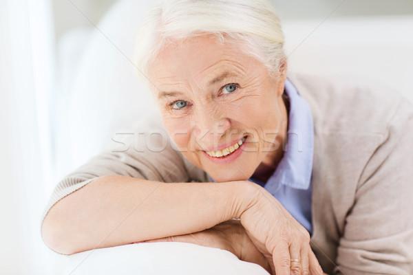 happy senior woman face at home Stock photo © dolgachov