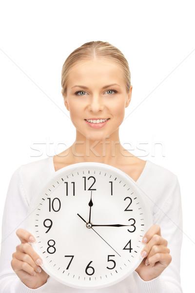 woman holding big clock Stock photo © dolgachov