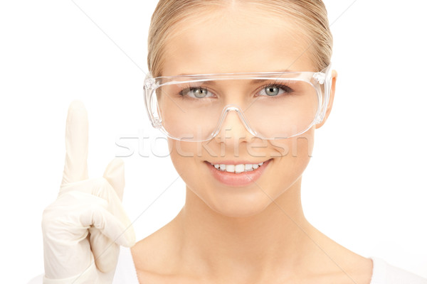 woman in protective glasses and gloves Stock photo © dolgachov