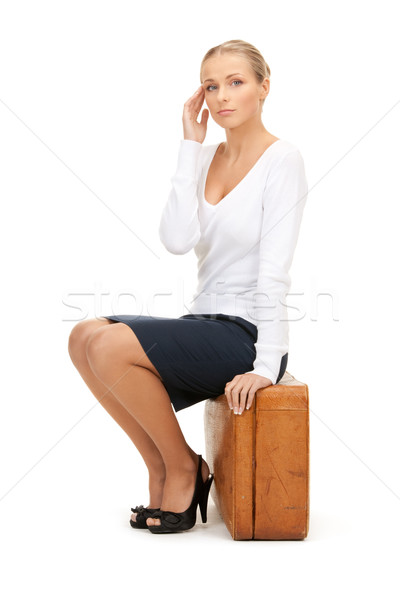 woman with brown suitcase Stock photo © dolgachov