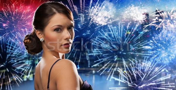 Mooie vrouw diamant oorbel vuurwerk mensen vakantie Stockfoto © dolgachov