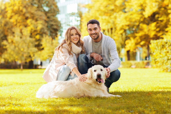 happy couple with labrador dog autumn in park Stock photo © dolgachov
