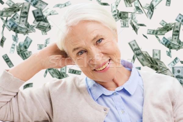 happy senior woman face over violet background Stock photo © dolgachov