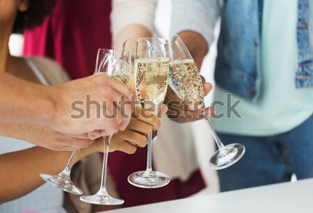 close up of male gay couple with champagne glass Stock photo © dolgachov