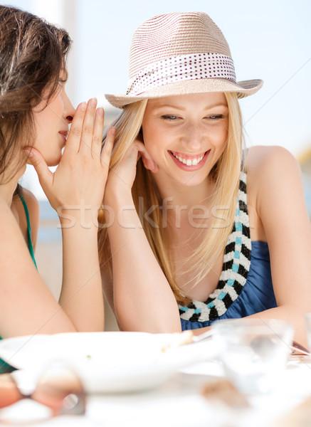 girls gossiping in cafe on the beach Stock photo © dolgachov