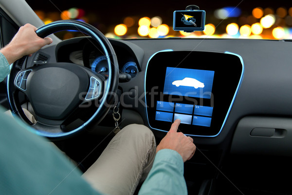 close up of man driving car with on board computer Stock photo © dolgachov