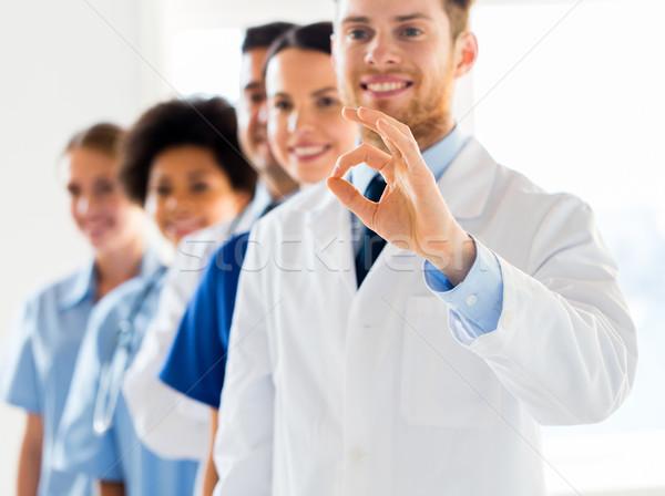 close up of doctors showing ok sign at hospital Stock photo © dolgachov