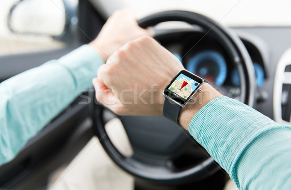 close up of man driving car with gps on smartwatch Stock photo © dolgachov