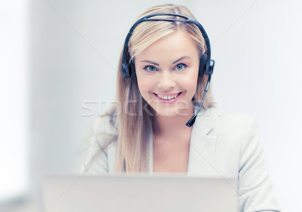 Stock photo: friendly female helpline operator with laptop
